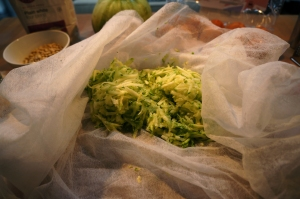 Gather up the grated veg in the cloth....