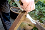 sawing the legs ready for a treatment on 'end stop'.