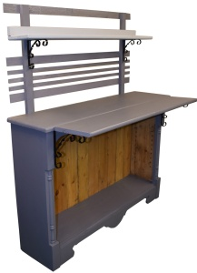 The finished potting bench painted in two shades of grey.