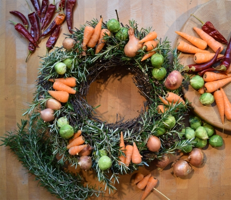 I skewered the carrots with cocktail sticks and rammed them into position. Chilies were sewn in. The base wreath I already had and was just plain twigs. I know, I cheated!